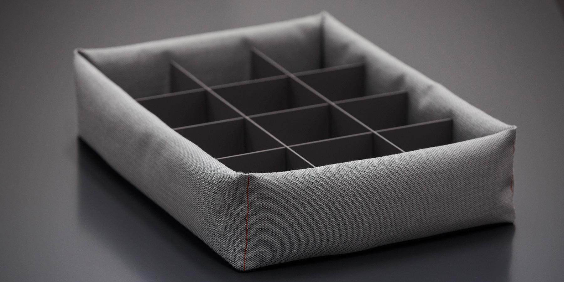 Schubkasten-Einteilung mit textil ummantelter Pillowbox